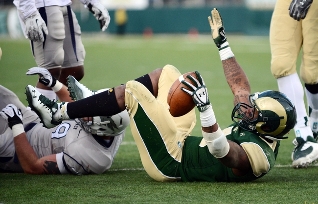 Nov 9, 2013; Fort Collins, CO, USA; Colorado State Rams running back Kapri Bibbs (5) reacts to his one yard rushing touchdown in the fourth quarter against the Nevada Wolf Pack at Hughes Stadium. The Rams defeated the Wolf Pack 38-17.Mandatory Credit: Ron Chenoy-USA TODAY Sports