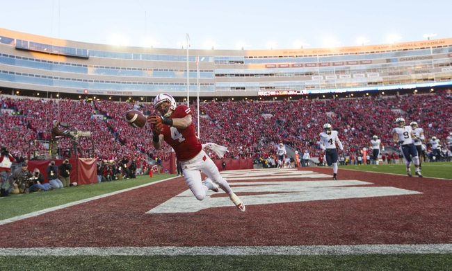Nov 9, 2013; Madison, WI, USA; Wisconsin Badgers wide receiver Jared Abbrederis (4) misses a pass in the end zone during the third quarter against the Brigham Young Cougars at Camp Randall Stadium. Wisconsin won 27-17.  Mandatory Credit: Jeff Hanisch-USA TODAY Sports