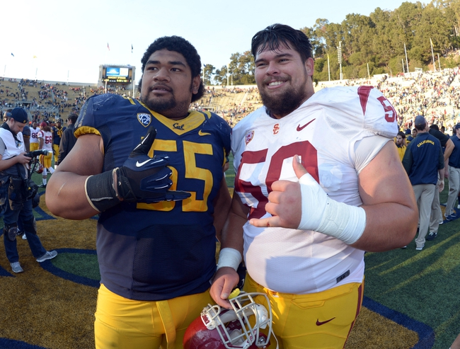 Nov 9, 2013; Berkeley, CA, USA; California Golden Bears defensive tackle Viliami Moala (55) and Southern California Trojans guard Abe Markowitz (50) pose after the game at Memorial Stadium. USC defeated California 62-28. Mandatory Credit: Kirby Lee-USA TODAY Sports