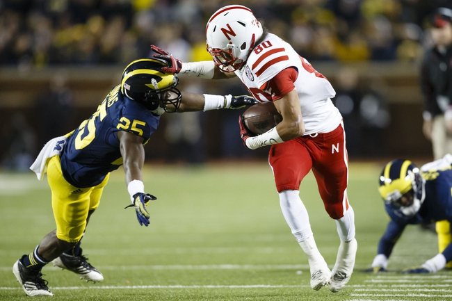 Nov 9, 2013; Ann Arbor, MI, USA; Nebraska Cornhuskers wide receiver Kenny Bell (80) stiff arms Michigan Wolverines defensive back Dymonte Thomas (25) as he runs the ball in the fourth quarter at Michigan Stadium. Nebraska won 17-13. Mandatory Credit: Rick Osentoski-USA TODAY Sports