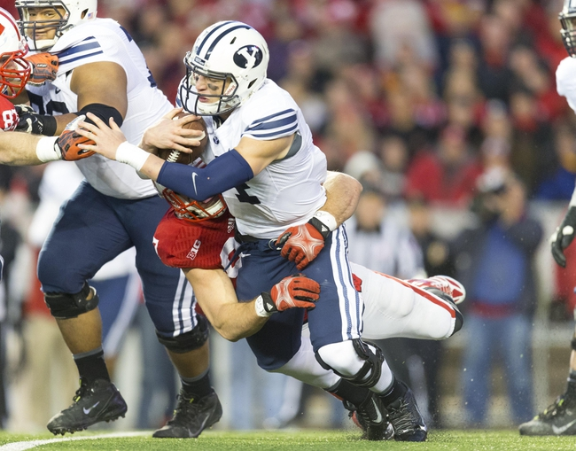 Nov 9, 2013; Madison, WI, USA; Wisconsin Badgers linebacker Brendan Kelly (97) sacks Brigham Young Cougars quarterback Taysom Hill (4) during the third quarter at Camp Randall Stadium. Wisconsin won 27-17.  Mandatory Credit: Jeff Hanisch-USA TODAY Sports