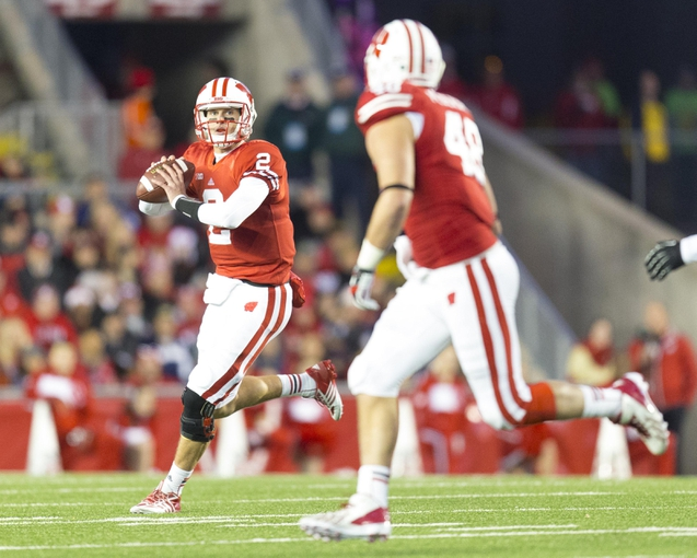 Nov 9, 2013; Madison, WI, USA; Wisconsin Badgers quarterback Joel Stave (2) looks to throw a pass to tight end Jacob Pedersen (48) during the third quarter against the Brigham Young Cougars at Camp Randall Stadium. Wisconsin won 27-17.  Mandatory Credit: Jeff Hanisch-USA TODAY Sports