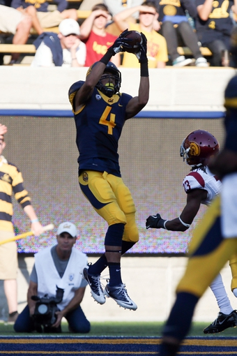 Nov 9, 2013; Berkeley, CA, USA; California Golden Bears wide receiver Kenny Lawler (4) catches the ball for a touchdown against the USC Trojans during the fourth quarter at Memorial Stadium. The USC Trojans defeated the California Golden Bears 62-28. Mandatory Credit: Kelley L Cox-USA TODAY Sports