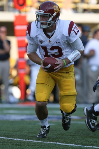 Nov 9, 2013; Berkeley, CA, USA; USC Trojans quarterback Max Wittek (13) looks to hand off the ball against the California Golden Bears during the fourth quarter at Memorial Stadium. The USC Trojans defeated the California Golden Bears 62-28. Mandatory Credit: Kelley L Cox-USA TODAY Sports