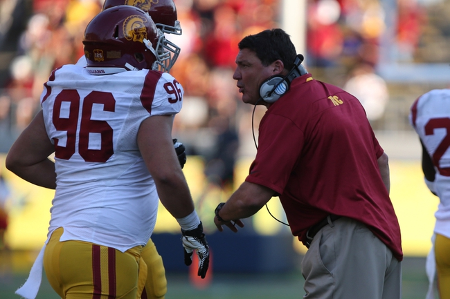 Nov 9, 2013; Berkeley, CA, USA; USC Trojans interim head coach Ed Orgeron talks to his players after a California Golden Bears touchdown and extra point during the fourth quarter at Memorial Stadium. The USC Trojans defeated the California Golden Bears 62-28. Mandatory Credit: Kelley L Cox-USA TODAY Sports