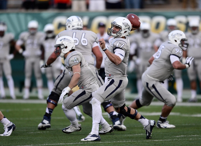 Nov 9, 2013; Fort Collins, CO, USA; Nevada Wolf Pack quarterback Cody Fajardo (17) prepares to pass in the fourth quarter against the Colorado State Rams at Hughes Stadium. The Rams defeated the Wolf Pack 38-17.Mandatory Credit: Ron Chenoy-USA TODAY Sports