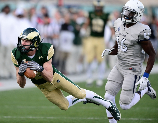 Nov 9, 2013; Fort Collins, CO, USA; Colorado State Rams wide receiver Thomas Coffman (2) pulls in a reception as Nevada Wolf Pack defensive back Kaodi Dike (16) defends in the fourth quarter at Hughes Stadium. The Rams defeated the Wolf Pack 38-17. Mandatory Credit: Ron Chenoy-USA TODAY Sports