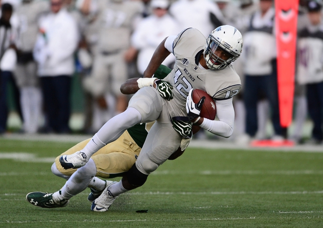 Nov 9, 2013; Fort Collins, CO, USA; Nevada Wolf Pack quarterback Dustin Treick (12) pulls in a reception as Colorado State Rams cornerback Shaq Bell (3) defends in the third quarter at Hughes Stadium. The Rams defeated the Wolf Pack 38-17.Mandatory Credit: Ron Chenoy-USA TODAY Sports