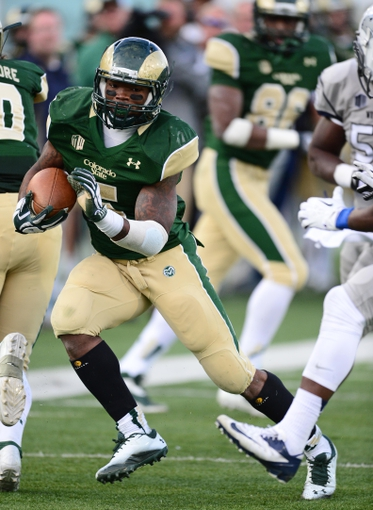 Nov 9, 2013; Fort Collins, CO, USA; Colorado State Rams running back Kapri Bibbs (5) rushes in the fourth quarter against the Nevada Wolf Pack at Hughes Stadium. The Rams defeated the Wolf Pack 38-17.Mandatory Credit: Ron Chenoy-USA TODAY Sports