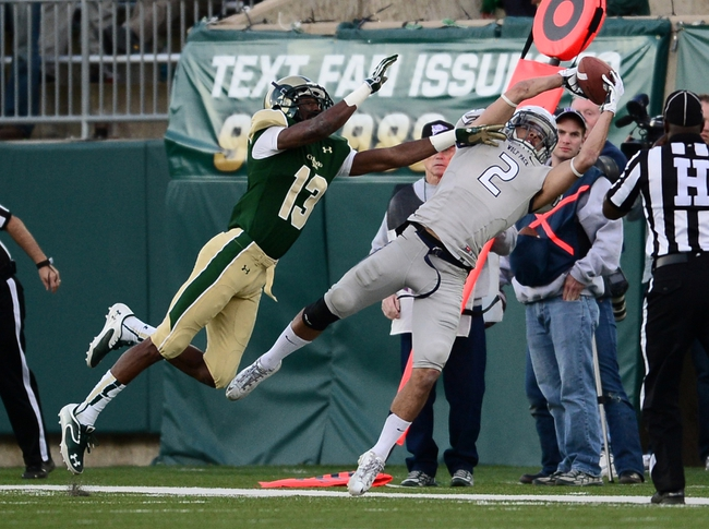 Nov 9, 2013; Fort Collins, CO, USA; Nevada Wolf Pack wide receiver Richy Turner (2) pulls in a reception as Colorado State Rams defensive back DeAndre Elliott (13) defends at in the fourth quarter Hughes Stadium. The Rams defeated the Wolf Pack 38-17.Mandatory Credit: Ron Chenoy-USA TODAY Sports