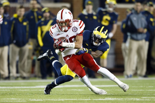 Nov 9, 2013; Ann Arbor, MI, USA; Nebraska Cornhuskers wide receiver Kenny Bell (80) runs the ball after making a reception in the second half against the Michigan Wolverines at Michigan Stadium. Mandatory Credit: Rick Osentoski-USA TODAY Sports