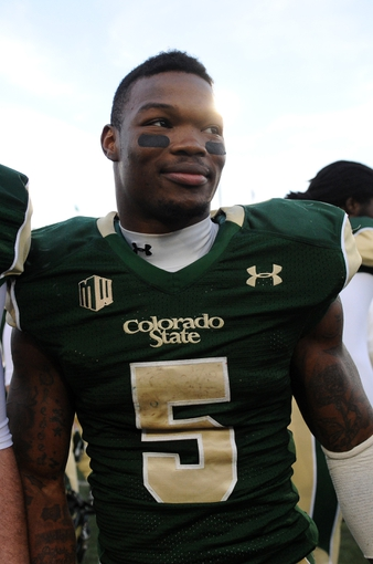 Nov 9, 2013; Fort Collins, CO, USA; Colorado State Rams running back Kapri Bibbs (5) leaves the field following the win over the Nevada Wolf Pack at Hughes Stadium. The Rams defeated the Wolf Pack 38-17. Mandatory Credit: Ron Chenoy-USA TODAY Sports