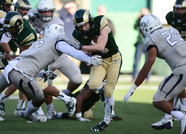 Nov 9, 2013; Fort Collins, CO, USA; Nevada Wolf Pack linebacker Bryan Lane Jr. (25) prepares to tackle Colorado State Rams wide receiver Thomas Coffman (2) in the third quarter at Hughes Stadium. The Rams defeated the Wolf Pack 38-17. Mandatory Credit: Ron Chenoy-USA TODAY Sports