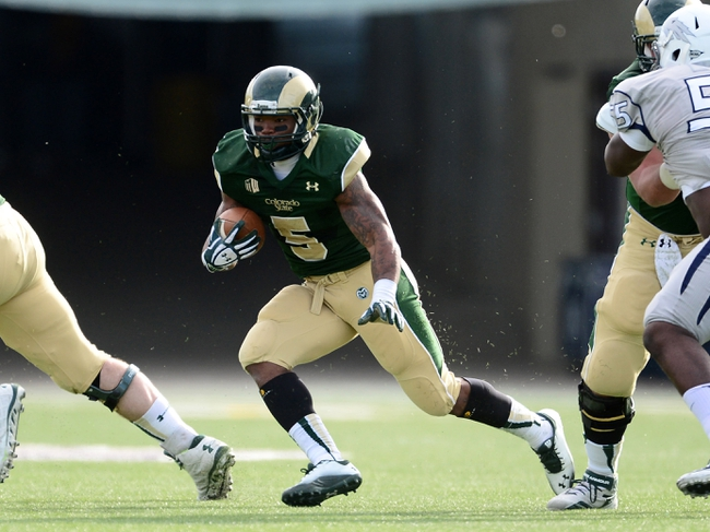 Nov 9, 2013; Fort Collins, CO, USA; Colorado State Rams running back Kapri Bibbs (5) rushes in the first quarter against the Nevada Wolf Pack at Hughes Stadium. The Rams defeated the Wolf Pack 38-17.Mandatory Credit: Ron Chenoy-USA TODAY Sports
