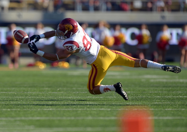 Nov 9, 2013; Berkeley, CA, USA; Southern California Trojans receiver George Katrib (83) attempts to catch a pass against the California Golden Bears at Memorial Stadium. USC defeated California 62-28. Mandatory Credit: Kirby Lee-USA TODAY Sports
