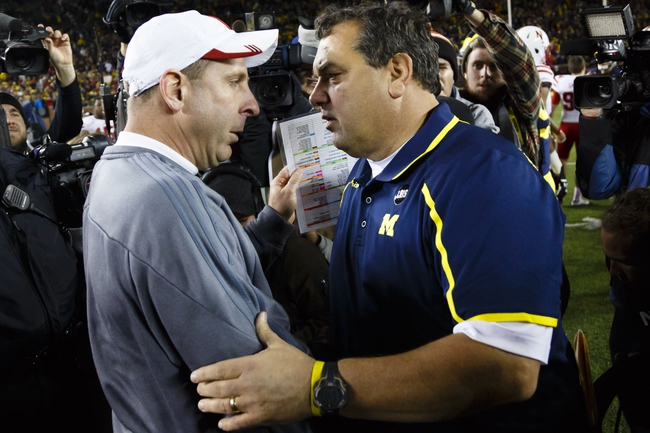 Nov 9, 2013; Ann Arbor, MI, USA; Nebraska Cornhuskers head coach Bo Pelini and Michigan Wolverines head coach Brady Hoke shake hands after the game at Michigan Stadium. Nebraska won 17-13. Mandatory Credit: Rick Osentoski-USA TODAY Sports