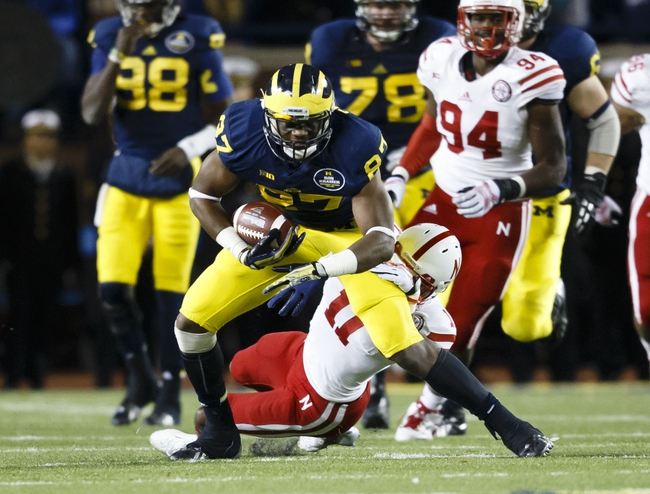Nov 9, 2013; Ann Arbor, MI, USA; Michigan Wolverines tight end Devin Funchess (87) is tackled by Nebraska Cornhuskers defensive back Andrew Green (11) in the fourth quarter at Michigan Stadium. Nebraska won 17-13. Mandatory Credit: Rick Osentoski-USA TODAY Sports