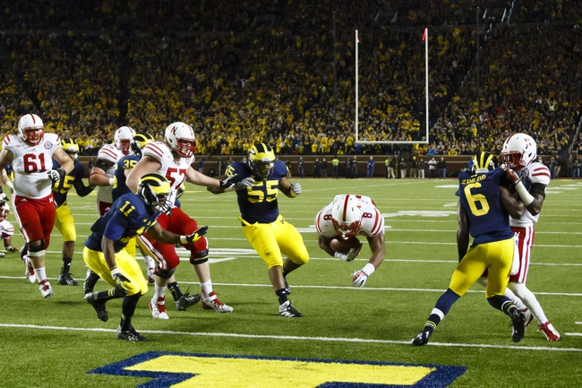 Nov 9, 2013; Ann Arbor, MI, USA; Nebraska Cornhuskers running back Ameer Abdullah (8) dive into the end zone for a touchdown in the fourth quarter against the Michigan Wolverines at Michigan Stadium. Nebraska won 17-13. Mandatory Credit: Rick Osentoski-USA TODAY Sports
