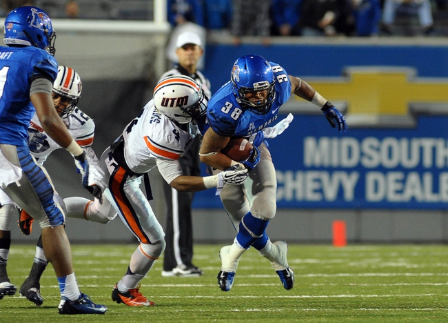 Nov 9, 2013; Memphis, TN, USA; Memphis Tigers running back Brandon Hayes (38) is tackled by Tennessee Martin Skyhawks defensive back Thad Williams (4) during the third quarter at Liberty Bowl Memorial. Mandatory Credit: Justin Ford-USA TODAY Sports