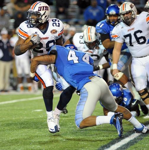 Nov 9, 2013; Memphis, TN, USA; Memphis Tigers linebacker Ryan Coleman (44) tackles Tennessee Martin Skyhawks running back Abou Toure (29) during the third quarter at Liberty Bowl Memorial. Mandatory Credit: Justin Ford-USA TODAY Sports