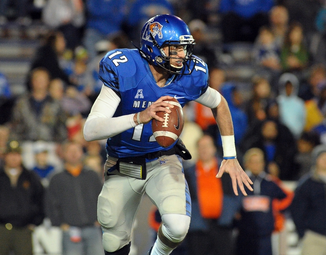 Nov 9, 2013; Memphis, TN, USA; Memphis Tigers quarterback Paxton Lynch (12) scrambles against Tennessee Martin Skyhawks during the third quarter at Liberty Bowl Memorial. Mandatory Credit: Justin Ford-USA TODAY Sports