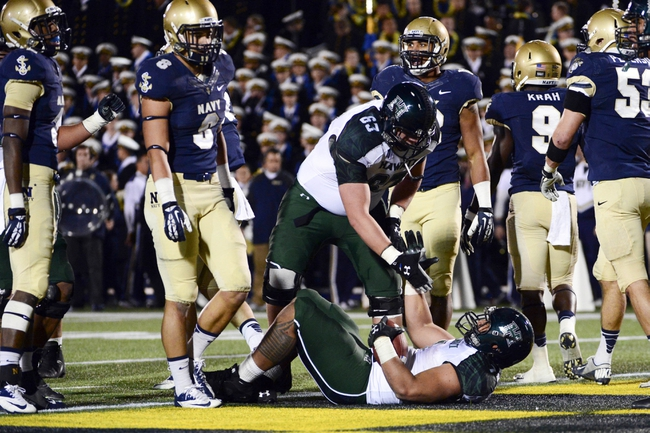 Nov 9, 2013; Annapolis, MD, USA; Hawaii Warriors offensive linesman Ben Dew (63) helps running back Joey Iosefa (7) up after scoring a touchdown during the fourth quarter against the Navy Midshipmen at Navy Marine Corps Memorial Stadium. Navy defeated Hawaii 42-38 Mandatory Credit: Tommy Gilligan-USA TODAY Sports