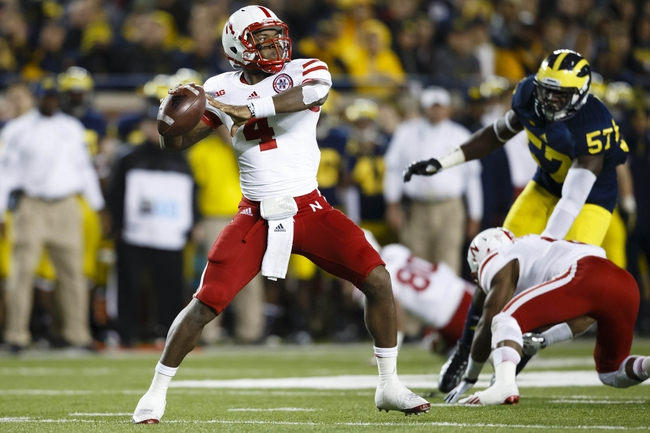 Nov 9, 2013; Ann Arbor, MI, USA; Nebraska Cornhuskers quarterback Tommy Armstrong Jr. (4) passes the ball in the third quarter against the Michigan Wolverines at Michigan Stadium. Nebraska won 17-13. Mandatory Credit: Rick Osentoski-USA TODAY Sports