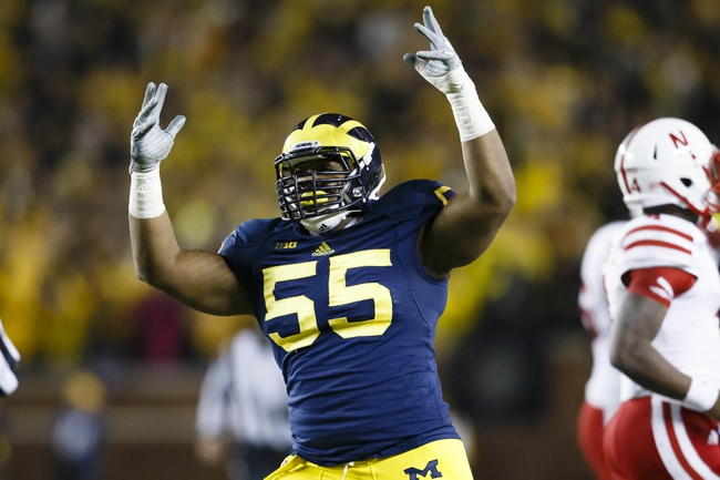 Nov 9, 2013; Ann Arbor, MI, USA; Michigan Wolverines defensive tackle Jibreel Black (55) reacts to a fumble recovery in the second half against the Nebraska Cornhuskers at Michigan Stadium.  Nebraska won 17-13. Mandatory Credit: Rick Osentoski-USA TODAY Sports