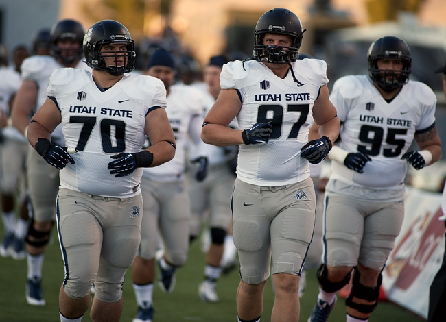 Nov 9, 2013; Las Vegas, NV, USA; Utah State Aggies players take to the field for warmups before an NCAA football game against the UNLV Rebels at Sam Boyd Stadium. Mandatory Credit: Stephen R. Sylvanie-USA TODAY Sports