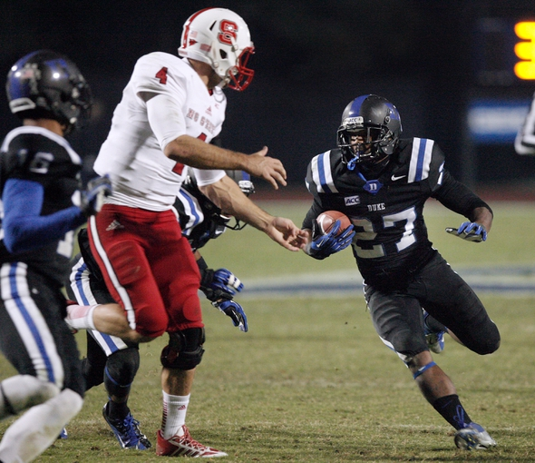 Nov 9, 2013; Durham, NC, USA; Duke Blue Devils cornerback DeVon Edwards (27) runs after intercepting a North Carolina State Wolfpack pass at Wallace Wade Stadium. Mandatory Credit: Mark Dolejs-USA TODAY Sports