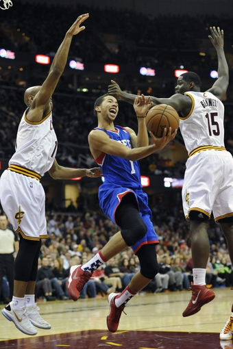 Nov 9, 2013; Cleveland, OH, USA; Philadelphia 76ers point guard Michael Carter-Williams (1) drives between Cleveland Cavaliers point guard Jarrett Jack (left) and small forward Anthony Bennett (15) in the first quarter at Quicken Loans Arena. Mandatory Credit: David Richard-USA TODAY Sports