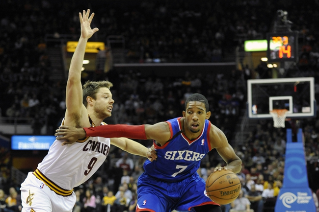 Nov 9, 2013; Cleveland, OH, USA; Philadelphia 76ers point guard Darius Morris (7) dribbles against Cleveland Cavaliers shooting guard Matthew Dellavedova (9) in the first quarter at Quicken Loans Arena. Mandatory Credit: David Richard-USA TODAY Sports