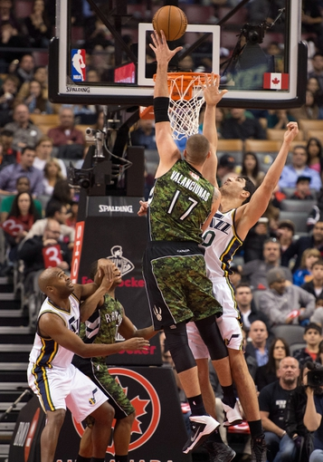 Nov 9, 2013; Toronto, Ontario, CAN; Toronto Raptors center Jonas Valanciunas (17) takes the ball to the basket  as Utah Jazz center Enes Kanter (0) tries to block during the first period in a game at Air Canada Centre. Mandatory Credit: Nick Turchiaro-USA TODAY Sports