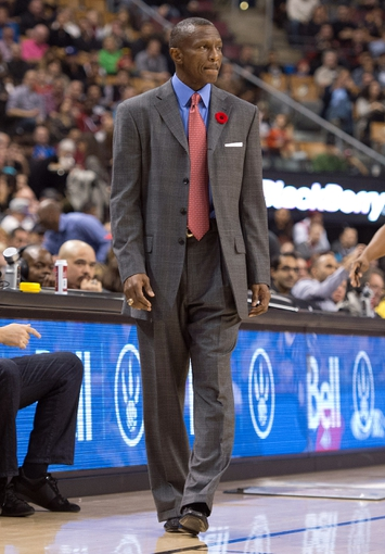 Nov 9, 2013; Toronto, Ontario, CAN; Toronto Raptors head coach Dwane Casey watches the action during the first period in a game against the Utah Jazz at Air Canada Centre. Mandatory Credit: Nick Turchiaro-USA TODAY Sports