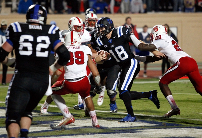 Nov 9, 2013; Durham, NC, USA; Duke Blue Devils quarterback Brandon Connette (18) runs the ball in for a touchdown against the North Carolina State Wolfpack at Wallace Wade Stadium. Mandatory Credit: Mark Dolejs-USA TODAY Sports