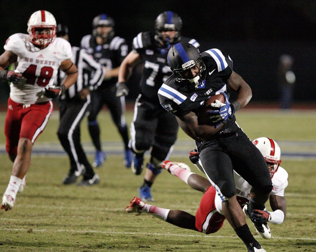 Nov 9, 2013; Durham, NC, USA; Duke Blue Devils running back Juwan Thompson (23) carries the ball against North Carolina State Wolfpack at Wallace Wade Stadium. Mandatory Credit: Mark Dolejs-USA TODAY Sports