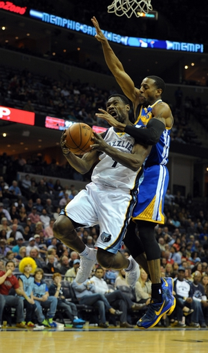 Nov 9, 2013; Memphis, TN, USA; Memphis Grizzlies shooting guard Tony Allen (9) is fouled by Golden State Warriors small forward Andre Iguodala (9) during the second quarter at FedExForum. Mandatory Credit: Justin Ford-USA TODAY Sports