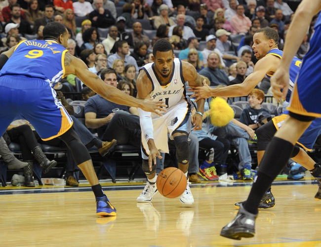 Nov 9, 2013; Memphis, TN, USA; Memphis Grizzlies point guard Mike Conley (11) handles the ball against Golden State Warriors the second quarter at FedExForum. Mandatory Credit: Justin Ford-USA TODAY Sports