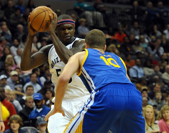 Nov 9, 2013; Memphis, TN, USA; Memphis Grizzlies power forward Zach Randolph (50) handles the ball against Golden State Warriors power forward David Lee (10) during the second quarter at FedExForum. Mandatory Credit: Justin Ford-USA TODAY Sports
