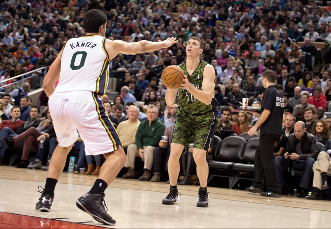 Nov 9, 2013; Toronto, Ontario, CAN; Toronto Raptors power forward Tyler Hansbrough (50) attempts a jump shot as Utah Jazz center Enes Kanter (0) tries to defend during the third period in a game at Air Canada Centre. The Toronto Raptors won 115-91. Mandatory Credit: Nick Turchiaro-USA TODAY Sports
