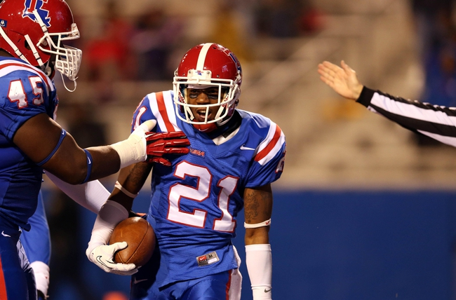 Nov 9, 2013; Ruston, LA, USA; Louisiana Tech Bulldogs defensive back Adairius Barnes (21) is congratulated by defensive lineman Vernon Butler (45) after a second quarter interception against the Southern Miss Golden Eagles at Joe Aillet Stadium. Mandatory Credit: Chuck Cook-USA TODAY Sports
