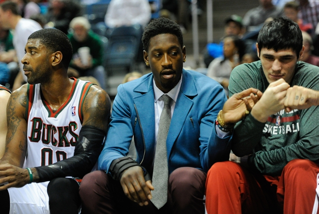 Nov 9, 2013; Milwaukee, WI, USA;  Milwaukee Bucks center Larry Sanders (center) sits on the bench with guard O.J. Mayo (left) and forward Ersan Ilyasova (right) in the 2nd quarter at BMO Harris Bradley Center. Sanders did not play after suffering a hand injury in an off-court incident.  Mandatory Credit: Benny Sieu-USA TODAY Sports