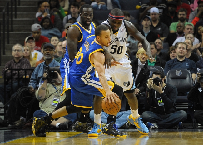 Nov 9, 2013; Memphis, TN, USA; Golden State Warriors point guard Stephen Curry (30) steals the ball from Memphis Grizzlies power forward Zach Randolph (50) during the third quarter at FedExForum. Mandatory Credit: Justin Ford-USA TODAY Sports