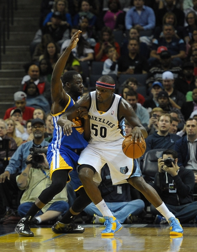 Nov 9, 2013; Memphis, TN, USA; Memphis Grizzlies power forward Zach Randolph (50) posts up against Golden State Warriors small forward Draymond Green (23) during the third quarter at FedExForum. Mandatory Credit: Justin Ford-USA TODAY Sports