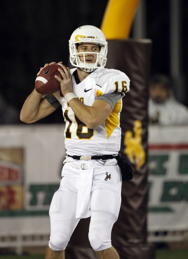 Nov 9, 2013; Laramie, WY, USA; Wyoming Cowboys quarterback Brett Smith (16) warms up before a game against the Fresno State Bulldogs at War Memorial Stadium. Mandatory Credit: Troy Babbitt-USA TODAY Sports