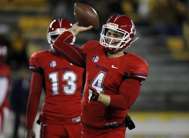 Nov 9, 2013; Laramie, WY, USA; Fresno State Bulldogs quarterback Derek Carr (4) warms up before a game against the Wyoming Cowboys at War Memorial Stadium. Mandatory Credit: Troy Babbitt-USA TODAY Sports