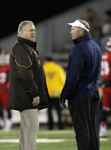 Nov 9, 2013; Laramie, WY, USA; Wyoming Cowboys head coach Dave Christensen and Fresno State Bulldogs head coach Tim DeRuyter before a game at War Memorial Stadium. Mandatory Credit: Troy Babbitt-USA TODAY Sports