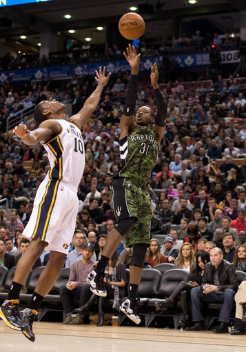 Nov 9, 2013; Toronto, Ontario, CAN; Toronto Raptors shooting guard Terrence Ross (31) attempts a jump shot as Utah Jazz point guard Alec Burks (10) tries to block  during the fourth period in a game at Air Canada Centre. The Toronto Raptors won 115-91. Mandatory Credit: Nick Turchiaro-USA TODAY Sports