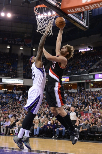 November 9, 2013; Sacramento, CA, USA; Portland Trail Blazers center Robin Lopez (42) dunks the ball against Sacramento Kings center DeMarcus Cousins (15, left) during the first quarter at Sleep Train Arena. Mandatory Credit: Kyle Terada-USA TODAY Sports