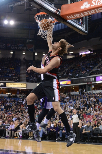November 9, 2013; Sacramento, CA, USA; Portland Trail Blazers center Robin Lopez (42) dunks the ball against the Sacramento Kings during the first quarter at Sleep Train Arena. Mandatory Credit: Kyle Terada-USA TODAY Sports